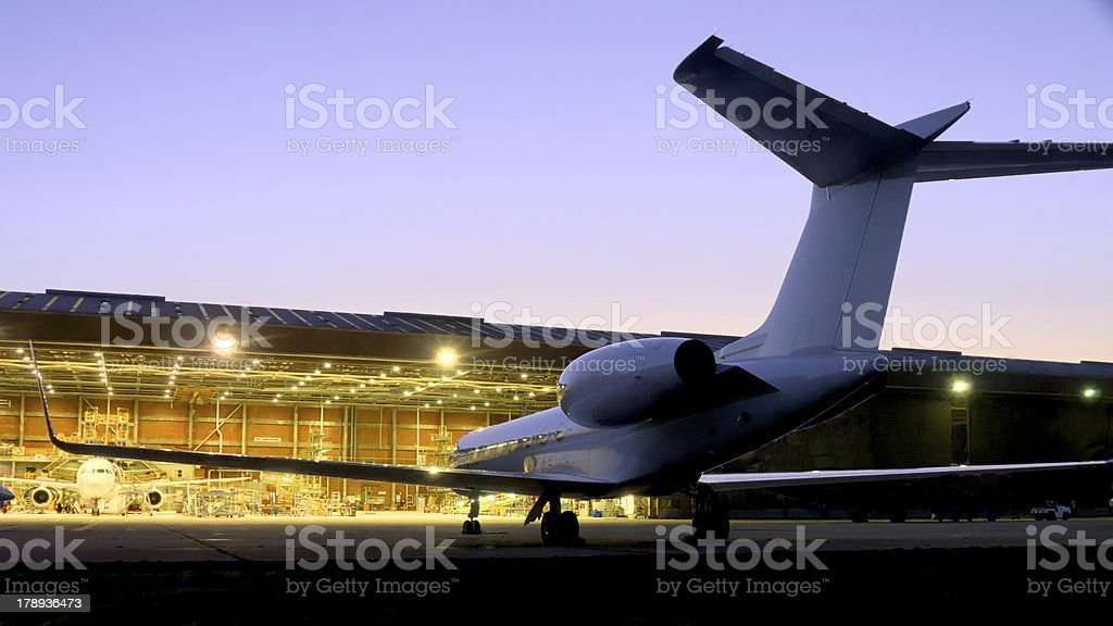 Small jet at airport hanger stock photo