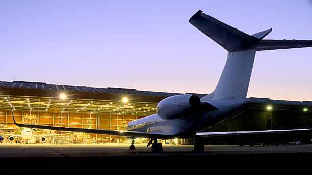 Small jet at airport hanger small jet sitting outside an airport hanger military private stock pictures, royalty-free photos & images