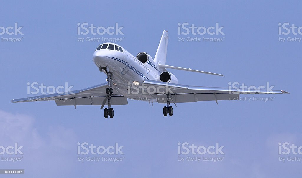 Small jet recently taken off with wheels still hanging out royalty-free stock photo