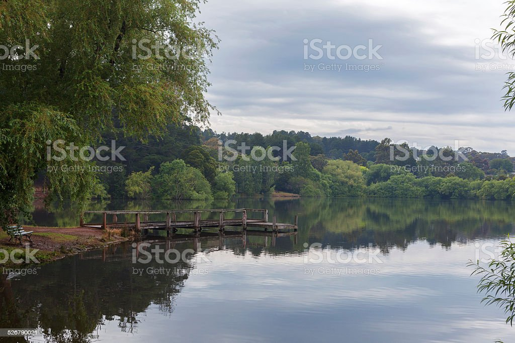 Small Jetty at Tranquil Daylesford Lake after spring rain stock photo
