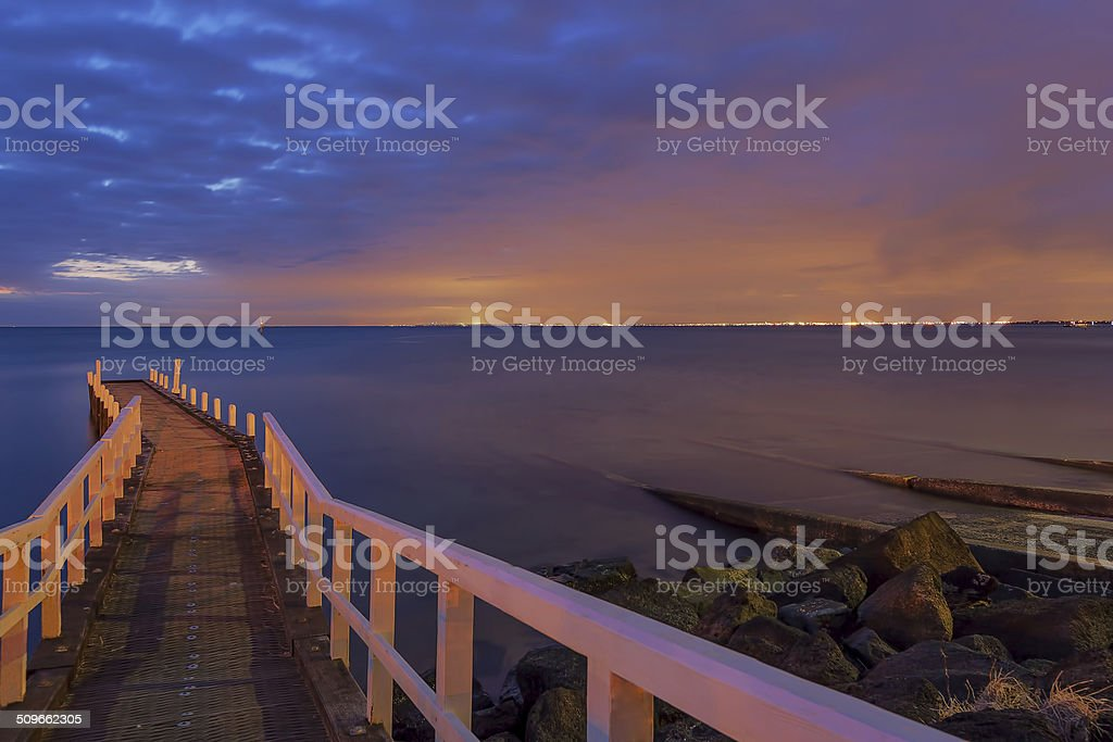 Small Jetty leading into the sunset stock photo
