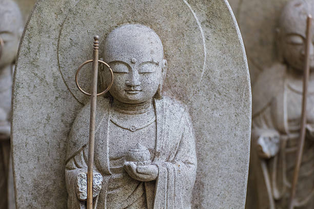 Small Jizo Statues at Hase-dera Temple in kama Kura Kamakura, Japan - November 24 2013: At Hase-dera temple, parents came to set up the statues in hopes the deity would protect their children bodhisattva stock pictures, royalty-free photos & images