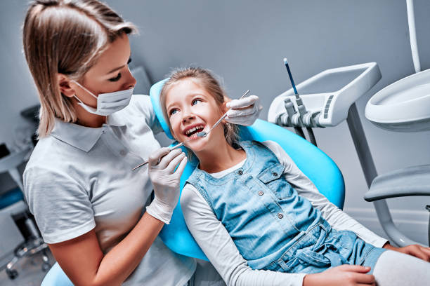 Small kid, patient visiting specialist in dental clinic stock photo