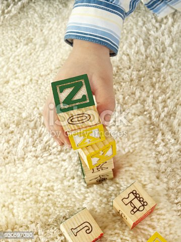 173937666 istock photo Small kid playing with cubes 930597030