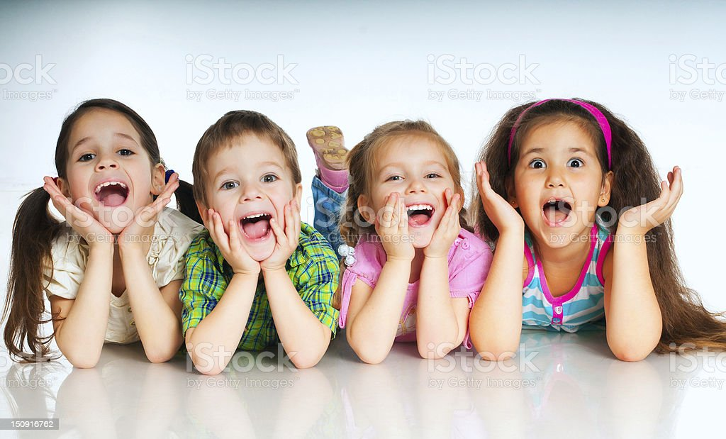 small kids laughing small kids on a white background Beautiful People Stock Photo