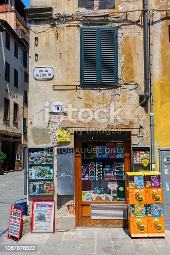 Lucca, Italy - July 01, 2016: small kiosk in the medieval old town of Lucca, Tuscany, with unidentified people. Lucca is famous for its intact Renaissance-era city walls