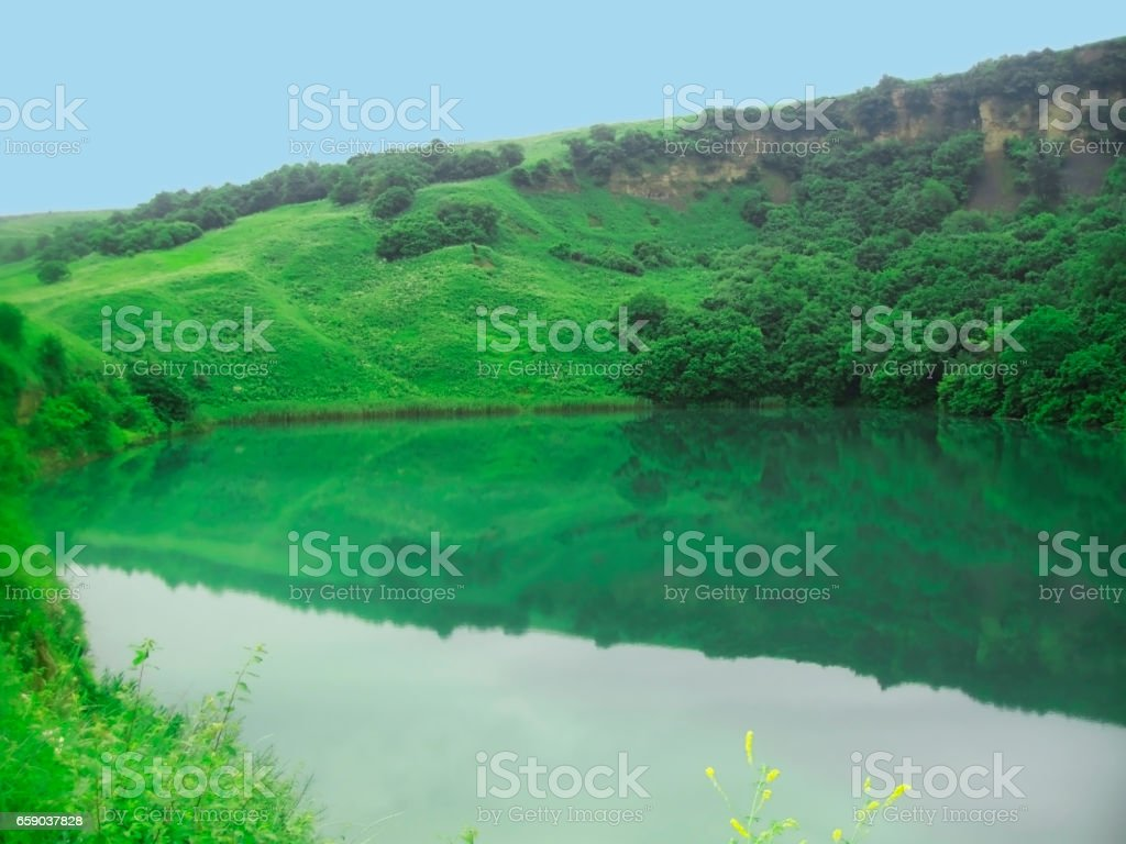 Small lake between the caucasus mountains summertime royalty-free stock photo