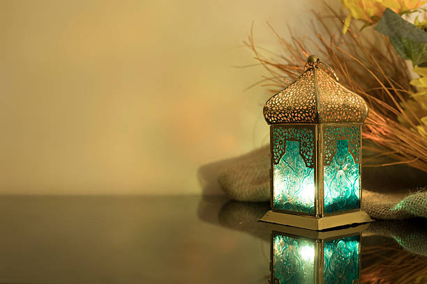 small lantern with straw in background - eid stock pictures, royalty-free photos & images