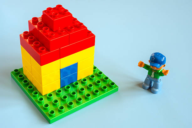 small lego house - lego house stock photos and pictures