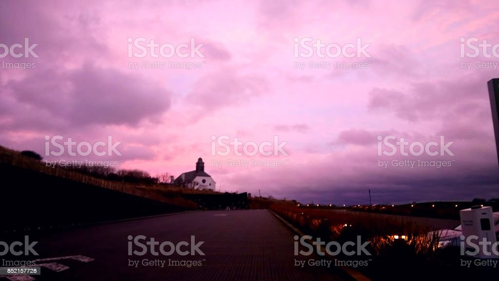 Small lighthouse and a pink sky stock photo