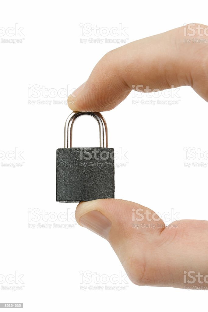 Small lock in hand royalty-free stock photo