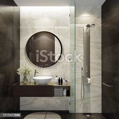 Luxurious bathroom with natural black stone tiles and white stone tiles. Round mirror. Small bathroom.