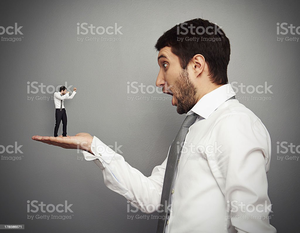 small man ready for fight with big businessman royalty-free stock photo