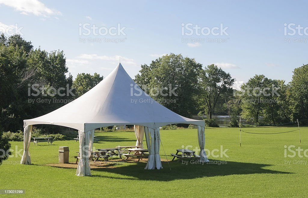 Small Marquee Tent with picnic tables in a park stock photo