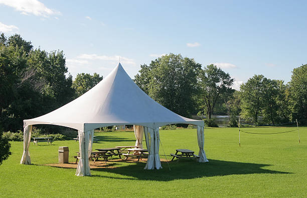 Small Marquee Tent with picnic tables in a park  entertainment tent stock pictures, royalty-free photos & images