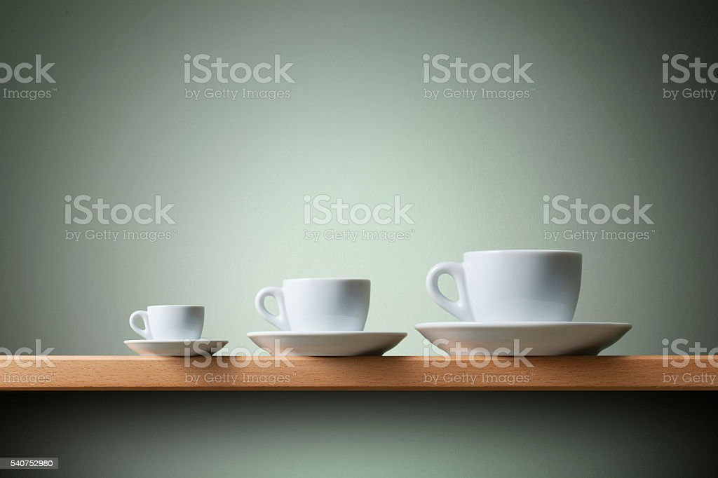 Small , medium and large. Coffee cups. stock photo