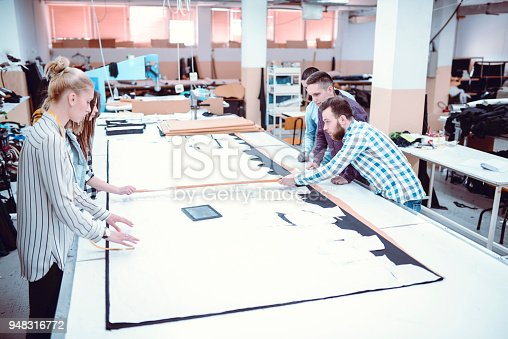 1083251186istockphoto Small Meeting About the New Project in Textile Factory 948316772