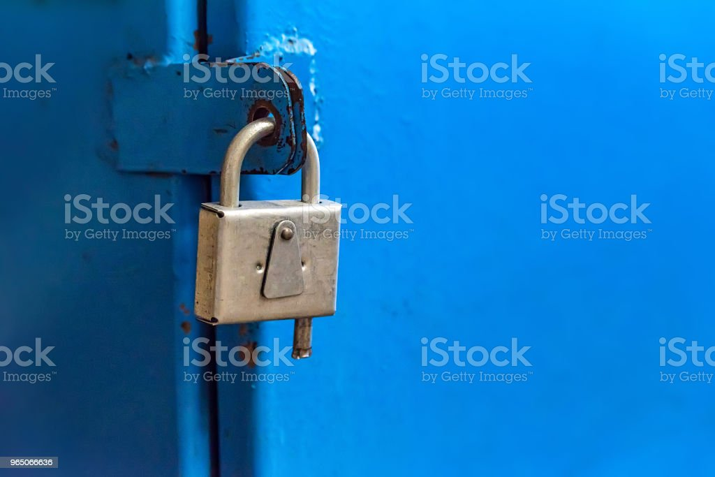 Small metal industrial padlock close royalty-free stock photo