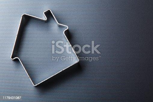 istock Small metallic house 1179431087