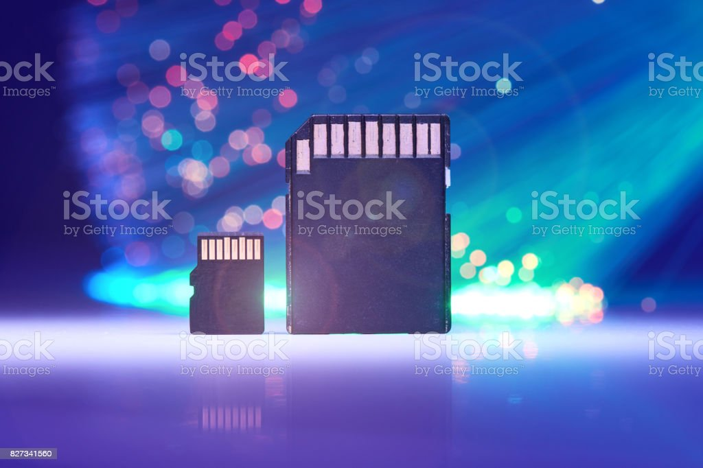 Small Micro Memory Card On Background With Fiber Optics stock photo