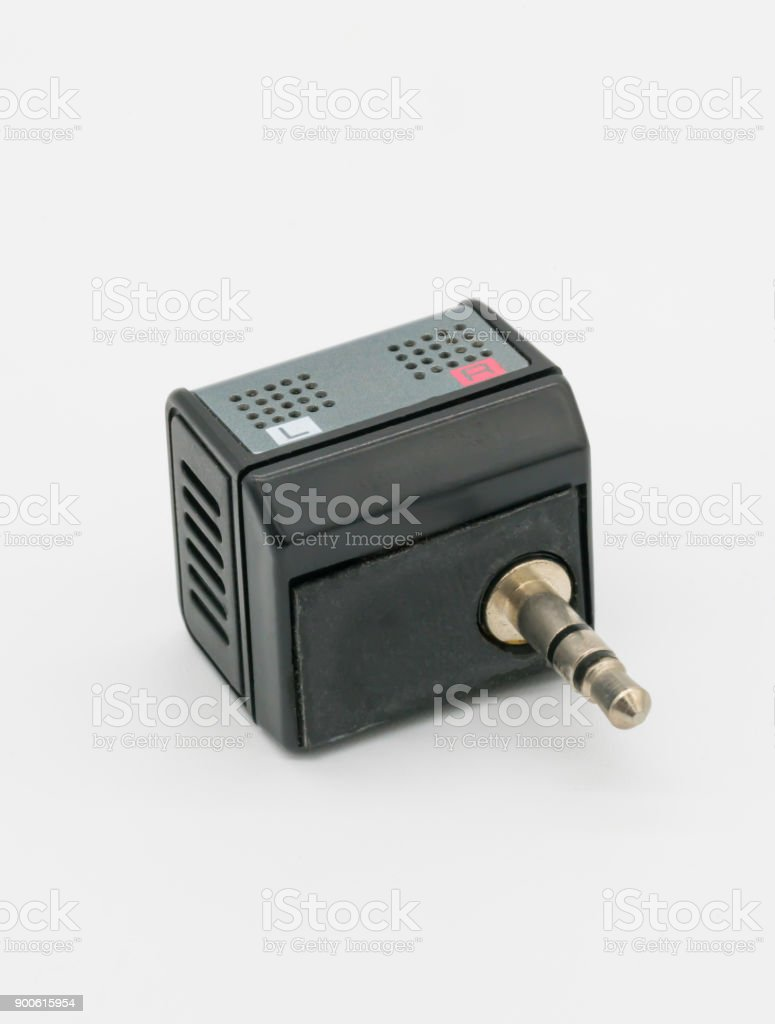 Small mini stereo microphone in metallic grey with 3.5mm audio jack connector stock photo