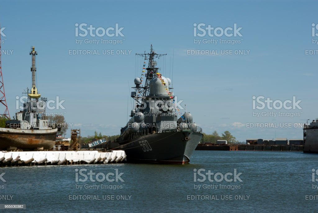 Small missile ship 'Swell' (on-Board 560) at the pier of the 33rd ship-repair plant stock photo