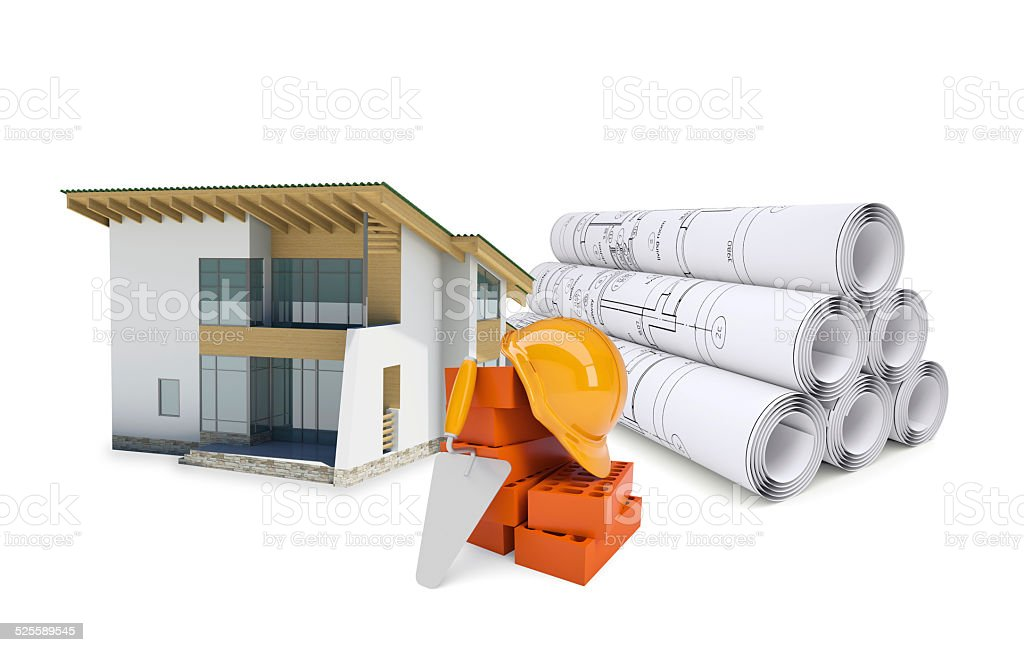 Small model house near scrolls of architectural drawings and work stock photo