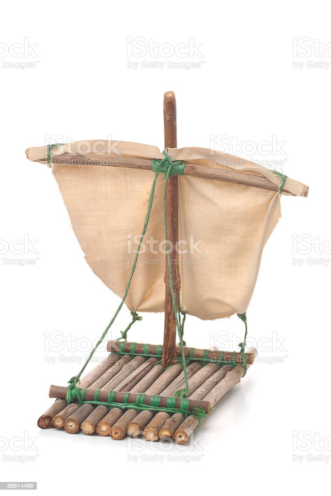 Small model of a raft with a sail on white background stock photo