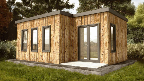 Small Modern Wooden House Exterior Small Modern Wooden House Exterior with landscape Background log cabin stock pictures, royalty-free photos & images