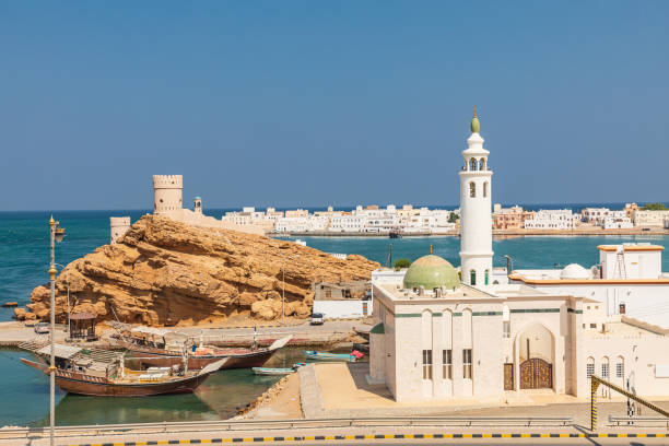 Small mosque on the harbor in Sur, Oman. stock photo