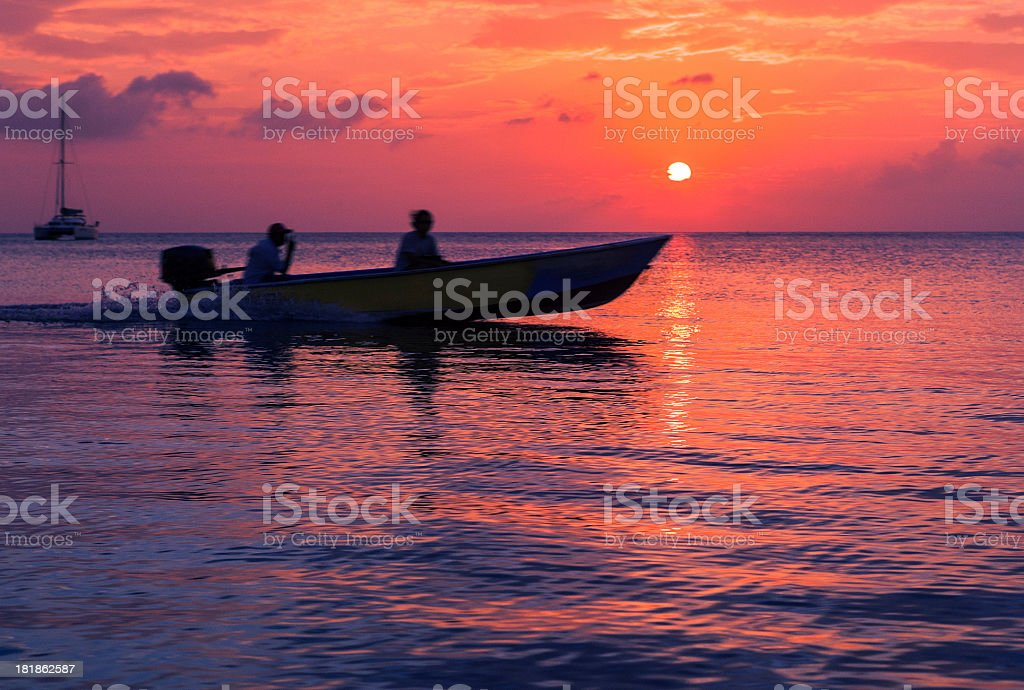 small motor boat at sunset stock photo