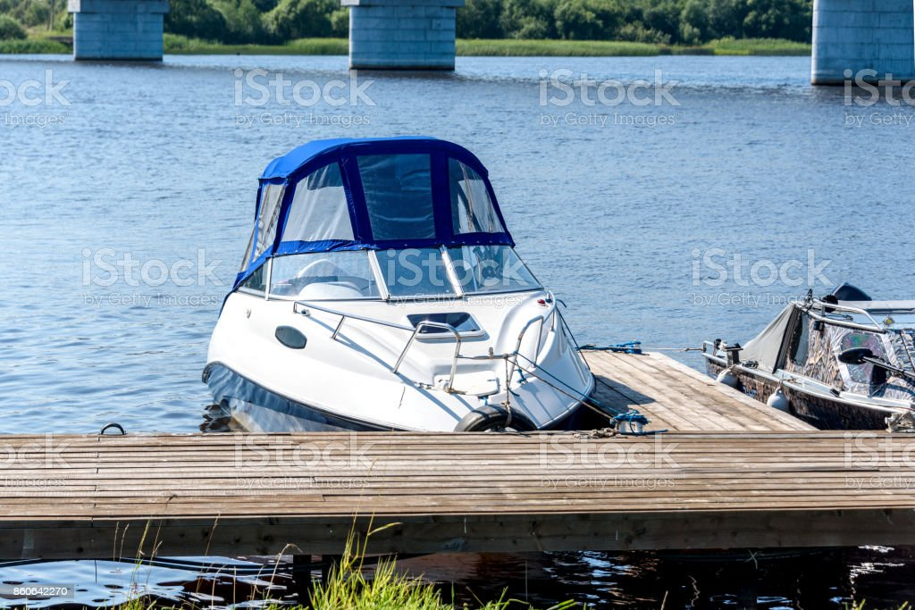 Small motor boat at the pier - foto stock