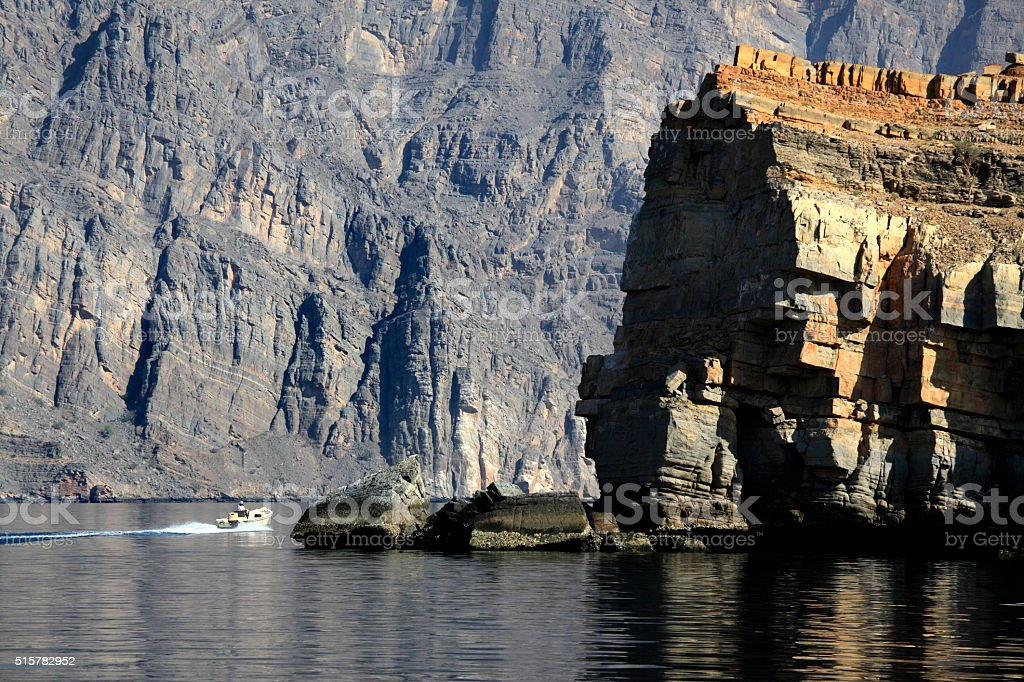 Small motor boat in the fjord, along Musandam coast, Oman stock photo