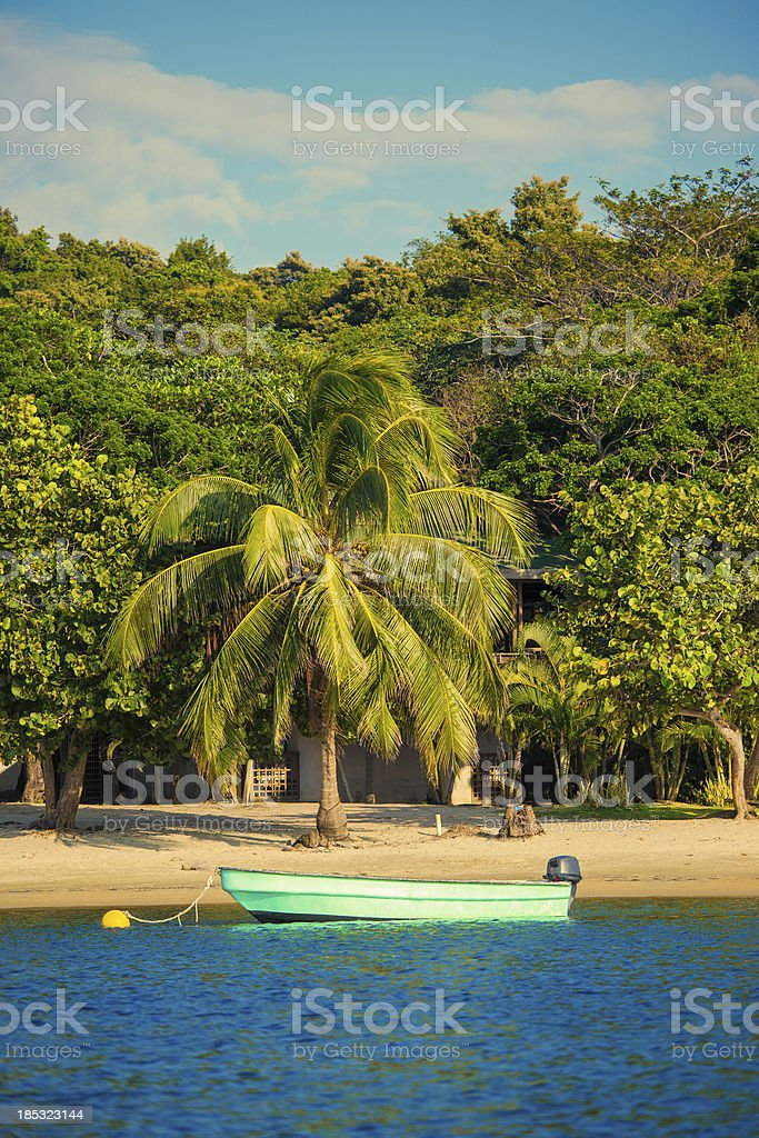 small motor boat moored at beach stock photo