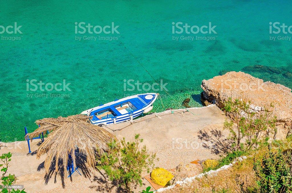 Small motorbat docked in peaceful bay stock photo