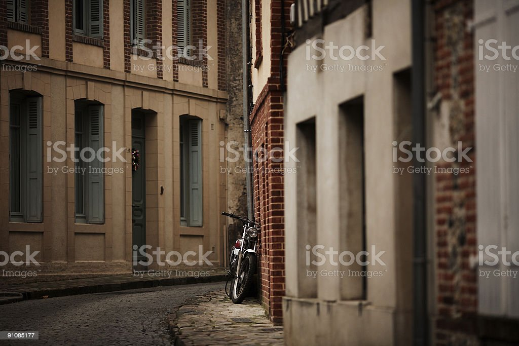 Small Motorcycle on Streetcorner royalty-free stock photo