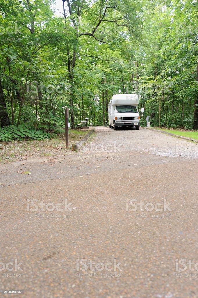 Small motorhome in campsite stock photo