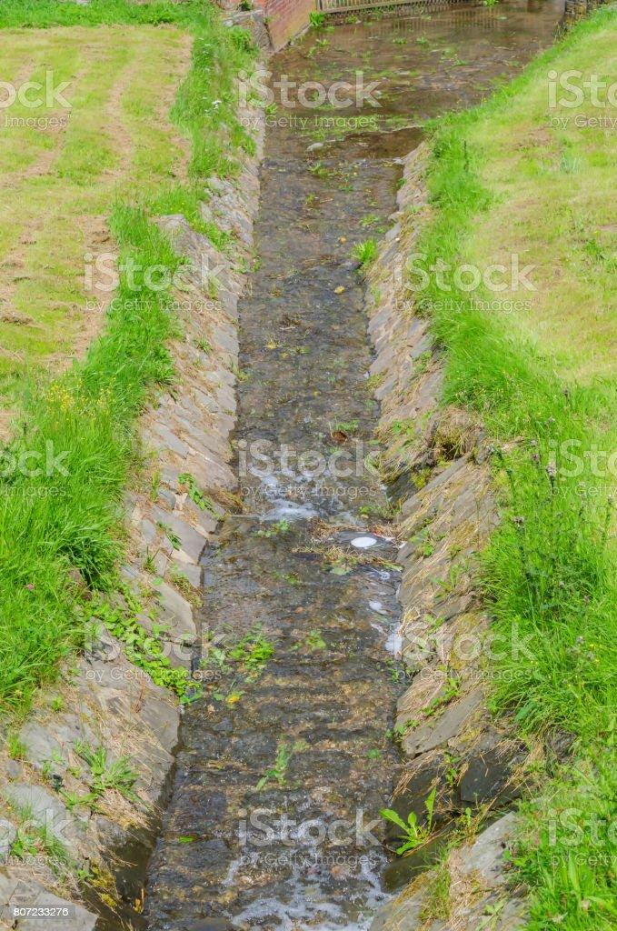 Small mountain stream over several small cascades stock photo