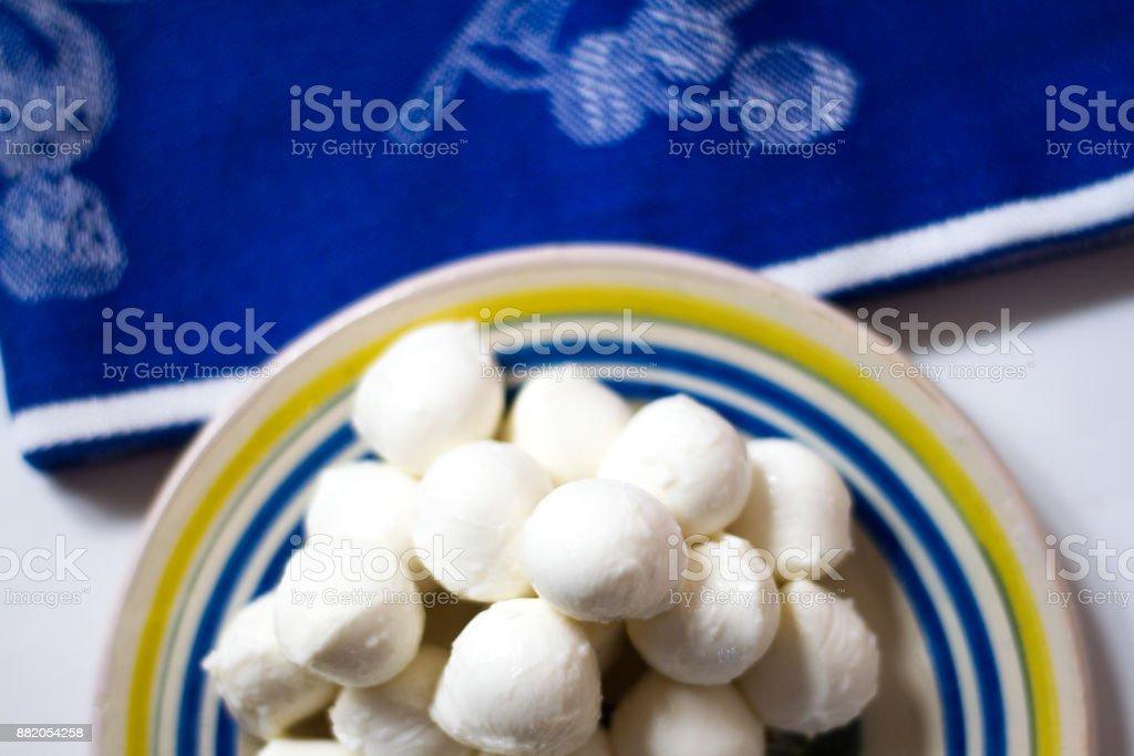 Small Mozzarella Balls (Bocconcini) on Plate with Napkin stock photo