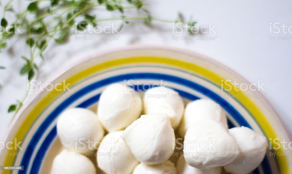 Small Mozzarella Balls (Bocconcini) on Plate with Thyme stock photo