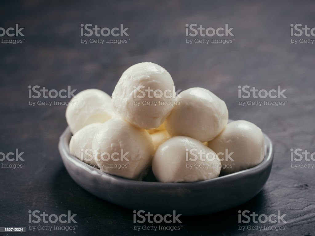 small mozzarella cheese stock photo