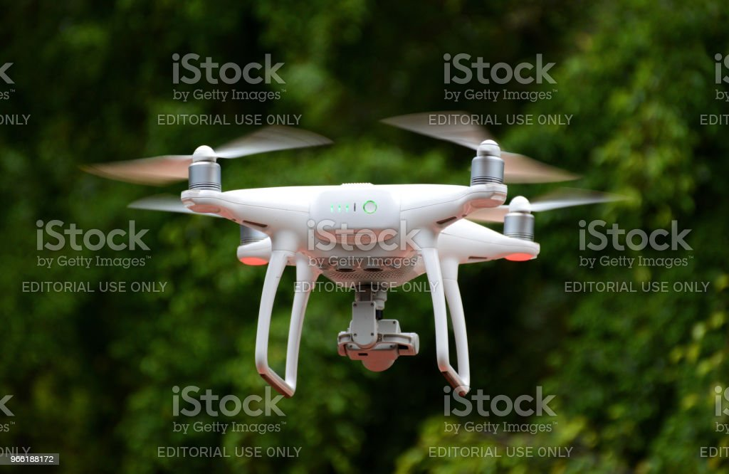 Small Non-Pilot DJI Drone Hovering In The Air Recording Video stock photo