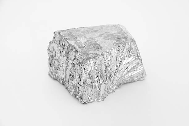small nugget of zinc on a white background - nickel stock photos and pictures