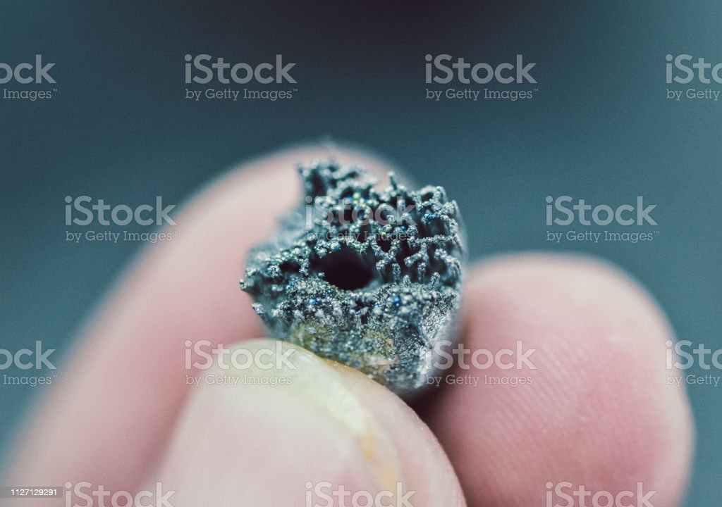 Small object printed on metal 3d printer macro stock photo