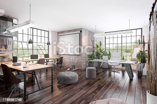 Small modern office interior with large office desks with laptops and blank projector screen with concrete wall in the background for copy space. Render.