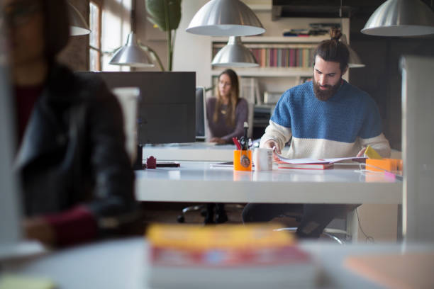 Small office with business people in Barcelona. stock photo