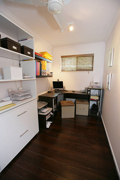 small office with corner desk and white decor - narrow stock photos and pictures