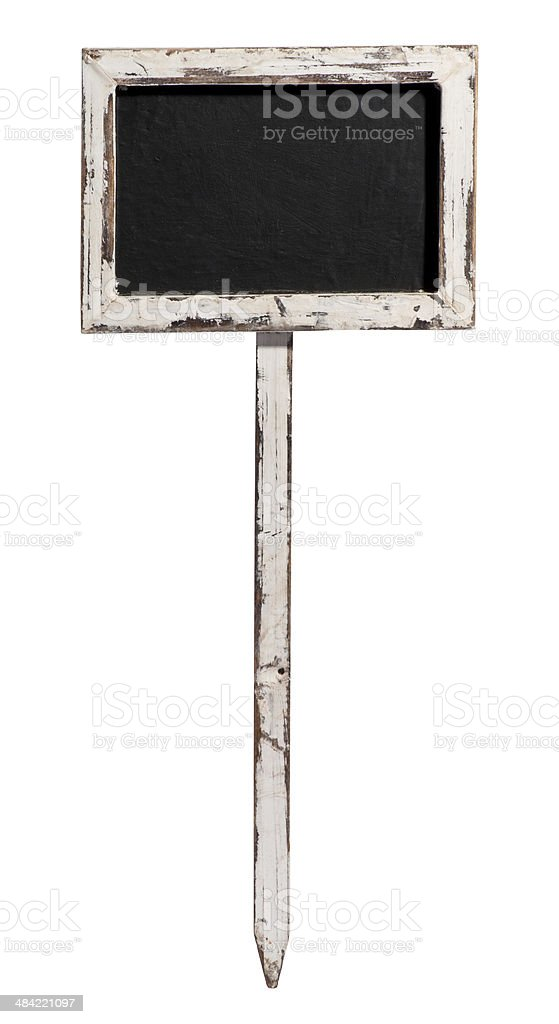 Small old blackboard on a wooden stake stock photo