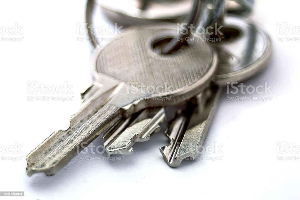 Small old keys isolated macro on white background stock photo