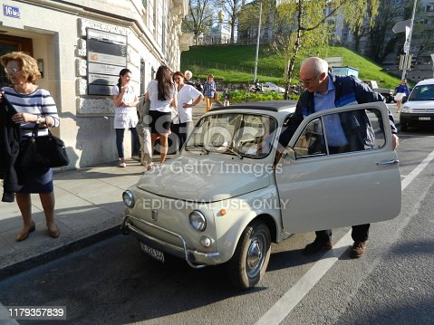 Geneva, Switzerland - April 17, 2013: White Fiat 600 in the Streets of Geneva in Switzerland. The Fiat 600 is a Rear-engine, Water-cooled City Car, Manufactured and Marketed by Fiat from 1955 to 1969.
